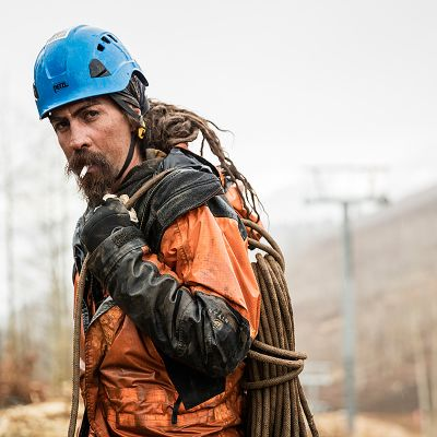 ski lift installer gritty portrait