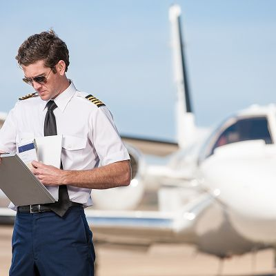 pilot with log book